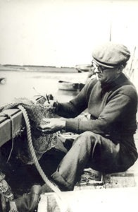 Frank Castelton mending fishing nets